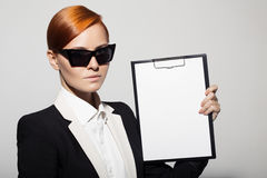 Fashion portrait of serious woman dressed as a secret agent Royalty Free Stock Photography