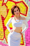 Fashion portrait of sexy brunette swag girl against the background of graffiti Royalty Free Stock Photos