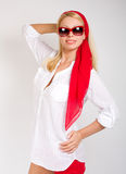 Fashion portrait of sexy woman wearing sunglasses. Fashion portrait of sexy woman wearing sunglasses in red scarf around head Royalty Free Stock Images