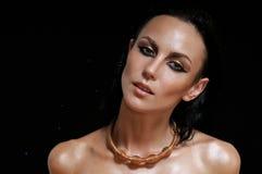 Fashion portrait of shining glamourous woman on black background Stock Image