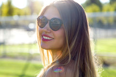 Fashion portrait of smiling cute young woman in the street. Stock Photography
