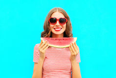 Fashion portrait smiling young woman is holding slice of watermelon Royalty Free Stock Image