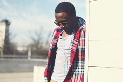 Fashion portrait of stylish african man with earphones Stock Image