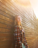 Fashion portrait stylish urban hipster girl outdoors in the city Stock Image