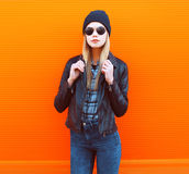 Fashion portrait of stylish woman in rock black style posing Stock Image