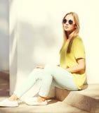 Fashion portrait of trendy pretty blonde woman in city Stock Image