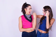 Fashion portrait of two women having fun. Friendship concept. Royalty Free Stock Photography