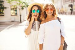 Two young stylish hippie brunette and blond women models royalty free stock photos