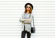 Fashion portrait woman with a black handbag on a white Stock Photo