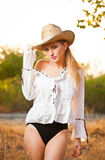 Fashion portrait woman with hat and white shirt in the autumn day Royalty Free Stock Images