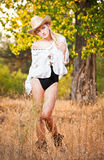 Fashion portrait woman with hat and white shirt in the autumn day Royalty Free Stock Photos