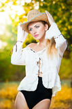 Fashion portrait woman with hat and white shirt in the autumn day Stock Image