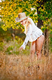 Fashion portrait woman with hat and white shirt in the autumn day Stock Photo