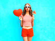 Fashion portrait woman is holding a red balloon heart shape and slice watermelon ice cream Stock Photography