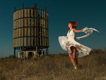 Fashion portrait woman twirling in white dress Royalty Free Stock Image