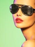 Fashion portrait of  woman wearing black sunglasses with diamond Stock Photo