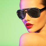 Fashion portrait of  woman wearing black sunglasses. With diamonds and red lips Stock Photos