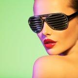 Fashion portrait of  woman wearing black sunglasses Stock Photos