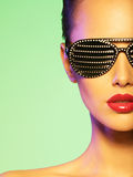 Fashion portrait of  woman wearing black sunglasses with strass. Stock Photo