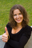 Fashion portrait of young attractive businesswoman. Giving the thumbs-up sign Stock Photos