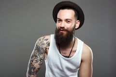 Smiling Hipster boy.handsome man in hat royalty free stock image