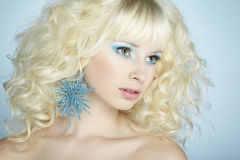 Fashion portrait of a young beautiful blonde woman. Winter style royalty free stock image