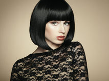 Fashion portrait of a young beautiful dark-haired woman stock image