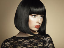 Fashion portrait of a young beautiful dark-haired woman. Vintage style Royalty Free Stock Image