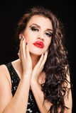 Fashion portrait of a young beautiful dark haired woman. Fashionable Brunette creative Makeup Woman with healthy dark curly Hair Stock Image