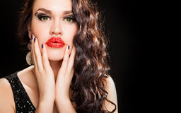 Fashion portrait of a young beautiful dark haired woman. Fashion Brunette creative Makeup Woman with healthy dark curly Hair Royalty Free Stock Photography