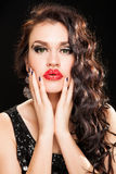 Fashion portrait of a young beautiful dark haired woman. Fashion Brunette creative Makeup Woman with healthy dark curly Hair Stock Photo