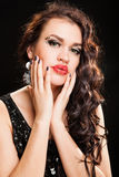 Fashion portrait of a young beautiful dark haired woman. Fashion Brunette creative Makeup and healthy dark curly Hair Royalty Free Stock Photography