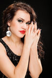 Fashion portrait of a young beautiful dark haired woman. Fashion Brunette creative Makeup Woman with healthy dark curly Hair Royalty Free Stock Images