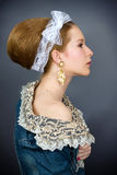 Fashion portrait of a young beautiful girl. With lace ribbon. Facial profile Royalty Free Stock Image