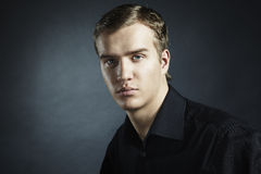 Fashion portrait of the young beautiful man Royalty Free Stock Image
