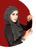 Fashion portrait of young beautiful muslim woman with black scar. F Stock Photography