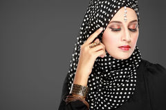 Fashion portrait of young beautiful muslim woman with black scar. F isolated on grey background Royalty Free Stock Photography
