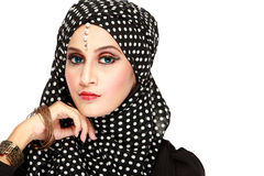 Fashion portrait of young beautiful muslim woman with black scar. F isolated on white background Stock Photo