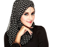 Fashion portrait of young beautiful muslim woman with black scar. F isolated on white background Stock Photos
