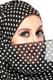Fashion portrait of young beautiful muslim woman with black scar. F isolated on white background Royalty Free Stock Photo