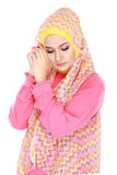 Fashion portrait of young beautiful muslim woman with pink costu Stock Photos