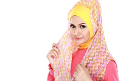Fashion portrait of young beautiful muslim woman with pink costu Royalty Free Stock Images