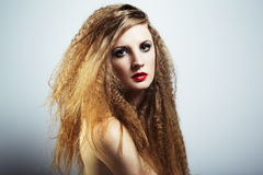 Fashion portrait of a young beautiful woman Royalty Free Stock Images