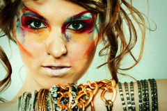 Fashion portrait of young beautiful woman. With stylish makeup Stock Images