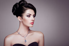 Fashion portrait of young beautiful woman with elegant hairstyle Royalty Free Stock Photos