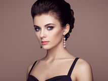 Fashion portrait of young beautiful woman with jewelry Royalty Free Stock Image