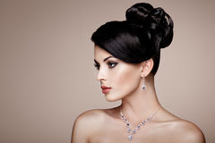 Fashion portrait of young beautiful woman with jewelry Stock Images