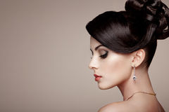 Fashion portrait of young beautiful woman with jewelry Stock Image