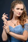 Fashion portrait of young beautiful woman with jewelry. Brunette stock photography