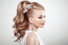 Fashion portrait of young beautiful woman with jewelry Royalty Free Stock Photos
